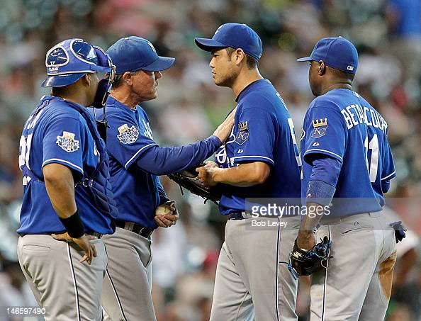 Manager Ned Yost takes the ball from Bruce Chen of the Kansas City Royals as Yuniesky Betancourt of the Kansas City Royals and Brayan Pena of the...
