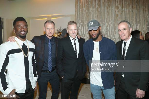 Manager Neil Dominique EVP of RCA Records Keith Naftaly CEO of RCA Records Peter Edge RCA recording artist Bryson Tiller and COO of RCA Records Tom...