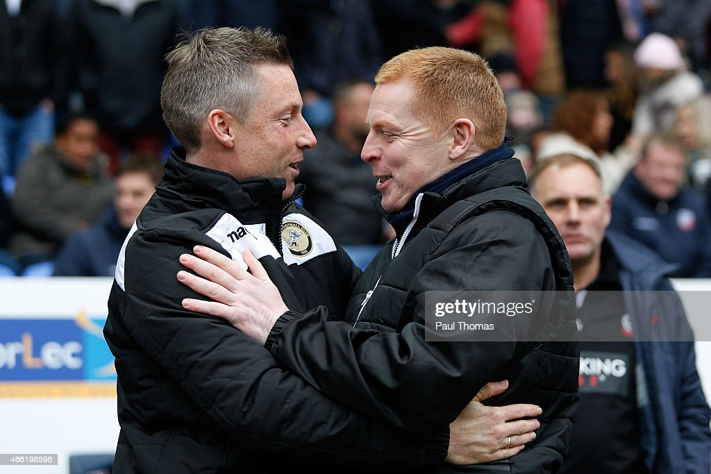 Manager Neil Lennon (R) of Bolton greets caretaker manager Neil Harris of Millwall before the Sky Bet Championship match between Bolton Wanderers and Millwall at the Macron Stadium on March 14, 2015 in Bolton, England.