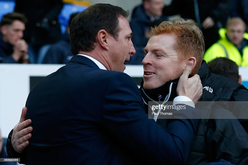 Manager <a gi-track='captionPersonalityLinkClicked' href=/galleries/search?phrase=Neil+Lennon&family=editorial&specificpeople=642944 ng-click='$event.stopPropagation()'>Neil Lennon</a> (R) of Bolton hugs Manager <a gi-track='captionPersonalityLinkClicked' href=/galleries/search?phrase=Malky+Mackay&family=editorial&specificpeople=227119 ng-click='$event.stopPropagation()'>Malky Mackay</a> of Wigan during the FA Cup Third Round match between Bolton Wanderers and Wigan Athletic at the Macron Stadium on January 3, 2015 in Bolton, England.