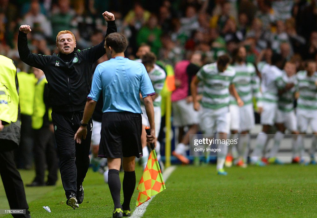 Manager Neil Lennon of Celtic celebrates after their third goal during the UEFA Champions League Play Off Round Second Leg match between Celtic and...
