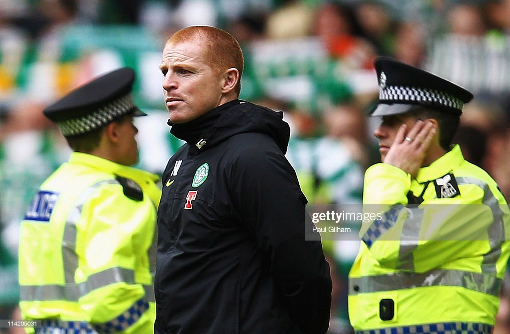 Manager <a gi-track='captionPersonalityLinkClicked' href=/galleries/search?phrase=Neil+Lennon&family=editorial&specificpeople=642944 ng-click='$event.stopPropagation()'>Neil Lennon</a> of Celtic, flanked by police officers, looks on as the crowd sing 'You'll never walk alone' at the end of the Clydesdale Bank Premier League match between Celtic and Motherwell at Celtic Park on May 15, 2011 in Glasgow, Scotland.