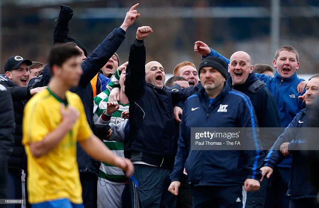 Manager Neil McNulty (C) of Oyster Martyrs celebrates with his players and fans at full time of The FA Sunday Cup Semi Final match between HT Sports v Oyster Martyrs at Nethermoor Park on March 17, 2013 in Guiseley, England.