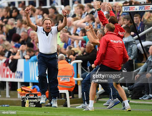 Manager Neil Warnock of Crystal Palace turns to celebrate with his coaching staff after Wilfried Zaha of Crystal Palace scored their third goal and...