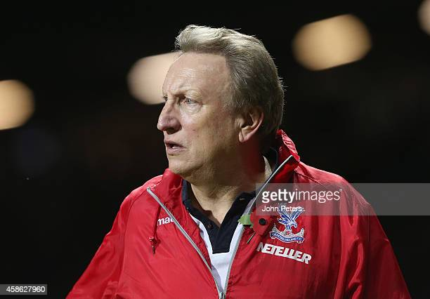 Manager Neil Warnock of Crystal Palace walks off after during the Barclays Premier League match between Manchester United and Crystal Palace at Old...