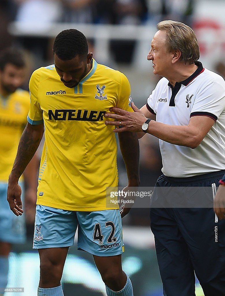 Manager <a gi-track='captionPersonalityLinkClicked' href=/galleries/search?phrase=Neil+Warnock&family=editorial&specificpeople=644786 ng-click='$event.stopPropagation()'>Neil Warnock</a> of Crystal Palace with <a gi-track='captionPersonalityLinkClicked' href=/galleries/search?phrase=Jason+Puncheon&family=editorial&specificpeople=747694 ng-click='$event.stopPropagation()'>Jason Puncheon</a> of Crystal Palace at the final whistle during the Barclays Premier League match between Newcastle United and Crystal Palace at St James' Park on August 30, 2014 in Newcastle upon Tyne, England.