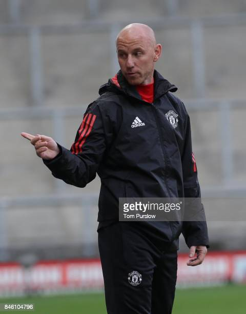 Manager Nicky Butt of Manchester United U19s watches from the touchline during the UEFA Youth League match between Manchester United U19s and FC...