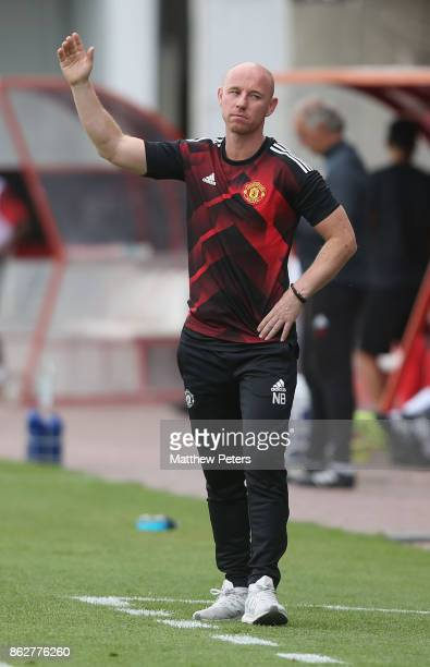 Manager Nicky Butt of Manchester United U19s watches from the touchline during the UEFA Youth League match between Benfica U19s and Manchester United...