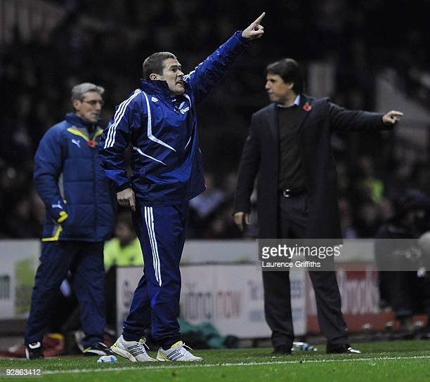 Manager Nigel Clough of Derby gestures to his players in front of Coventry manager Chris Coleman during the CocaCola Championship match between Derby...