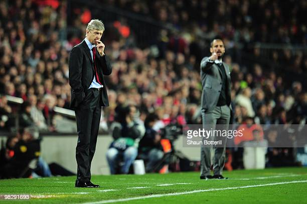 Manager of Arsenal Arsene Wenger and manager of Barcelona Josep Guardiola react on the touchline during the UEFA Champions League quarter final...