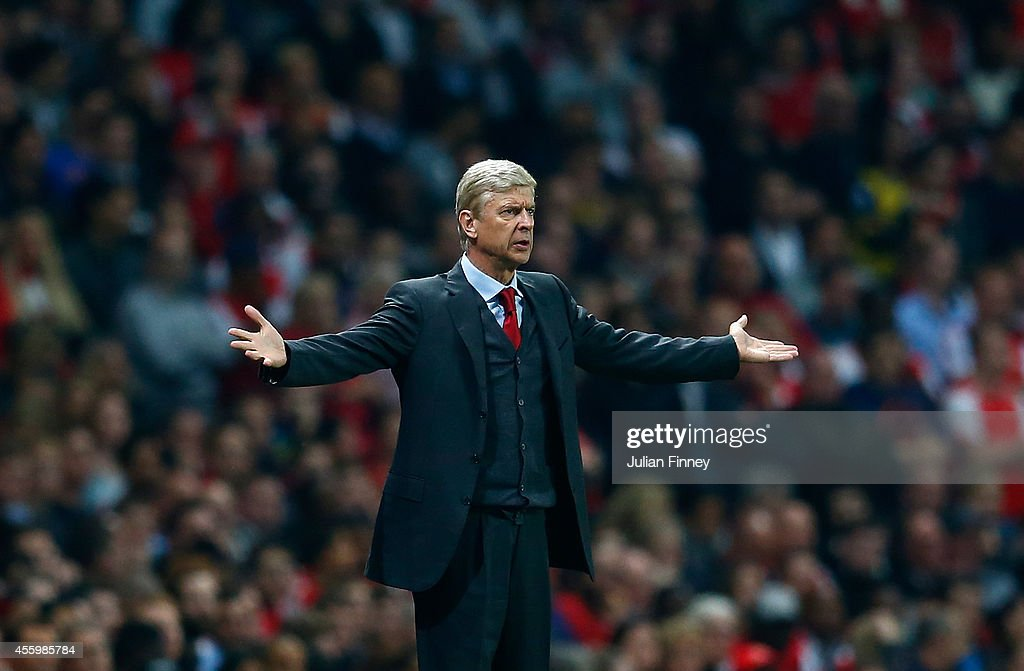 Manager of Arsenal, Arsene Wenger reacts during the Capital One Cup Third Round match between Arsenal and Southampton at the Emirates Stadium on September 23, 2014 in London, England.