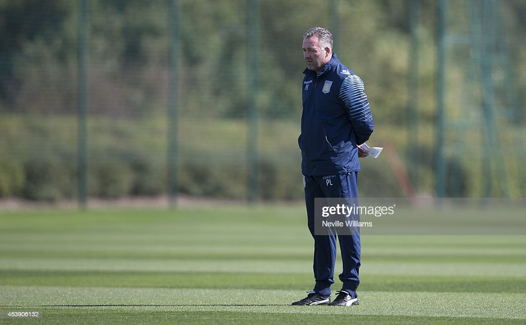 Manager of Aston Villa Paul Lambert looks on during an Aston Villa training session at the club's training ground at Bodymoor Heath on August 21, 2014 in Birmingham, England.