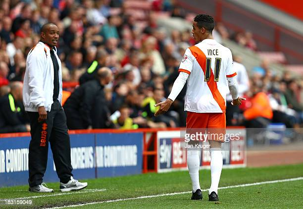 Manager of Blackpool Paul Ince looks on as Thomas Ince of Blackpool shows his frustration during the Sky Bet Championship match between Charlton...
