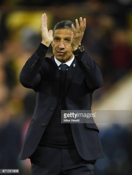 Manager of Brighton and Hove Albion Chris Hughton applauds supporters during the Sky Bet Championship match between Norwich City and Brighton Hove...