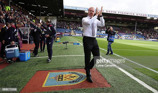 Manager of Burnley Sean Dyche waves to the fans before the Premier League match between Burnley and Swansea City at Turf Moor on August 13 2016 in...