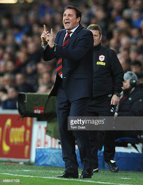 Manager of Cardiff City Malky Mackay gives instructions during the Barclays Premier League match between Cardiff City and West Bromwich Albion at...