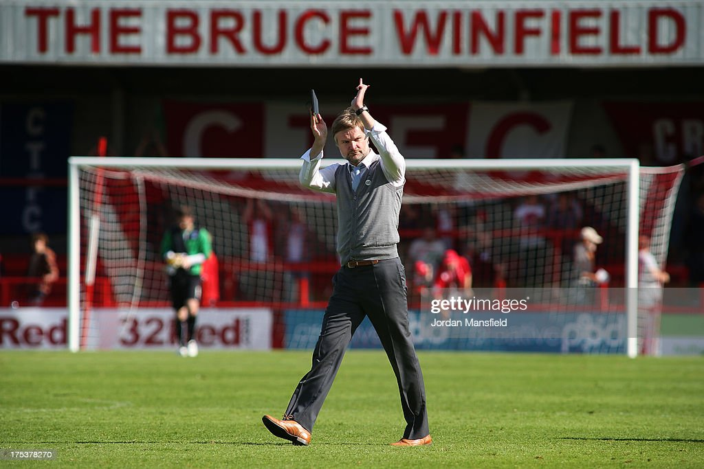 Manager of Coventry City Steven Pressley applauds the fans after the Sky Bet League One match between Crawley Town FC and Coventry at Broadfield Stadium on August 03, 2013 in Crawley, West Sussex,