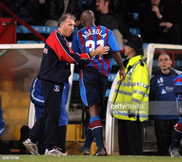 Manager of Crystal Palace Trevor Francis gives Dele Adebola a pat on the back after a 00 draw in the Nationwide Division One match at Palace's...