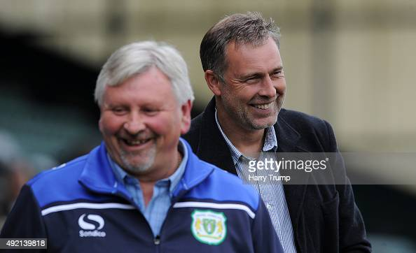 Manager of Dagenham Redbridge Wayne Burnett and Manager of Yeovil Town Paul Sturrock share a joke during the Sky Bet League Two match between Yeovil...
