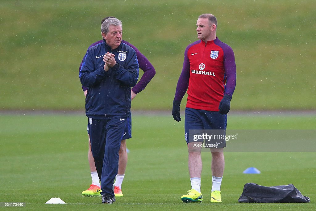 Manager of England <a gi-track='captionPersonalityLinkClicked' href=/galleries/search?phrase=Roy+Hodgson&family=editorial&specificpeople=881703 ng-click='$event.stopPropagation()'>Roy Hodgson</a> and <a gi-track='captionPersonalityLinkClicked' href=/galleries/search?phrase=Wayne+Rooney&family=editorial&specificpeople=157598 ng-click='$event.stopPropagation()'>Wayne Rooney</a> of England looks on during the England training session at Manchester City Football Academy on May 25, 2016 in Manchester, England.