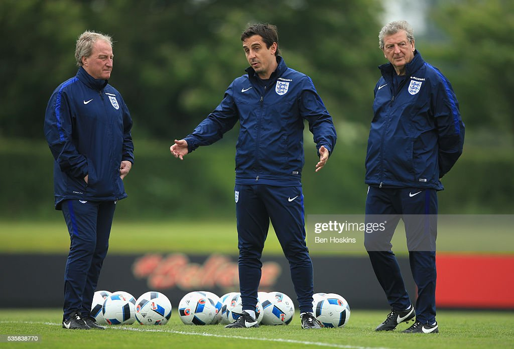 Manager of England, <a gi-track='captionPersonalityLinkClicked' href=/galleries/search?phrase=Roy+Hodgson&family=editorial&specificpeople=881703 ng-click='$event.stopPropagation()'>Roy Hodgson</a>, Assistant Manager of England, <a gi-track='captionPersonalityLinkClicked' href=/galleries/search?phrase=Gary+Neville&family=editorial&specificpeople=171409 ng-click='$event.stopPropagation()'>Gary Neville</a> and <a gi-track='captionPersonalityLinkClicked' href=/galleries/search?phrase=Ray+Lewington&family=editorial&specificpeople=224730 ng-click='$event.stopPropagation()'>Ray Lewington</a> look on during an England training session at London Colney on May 30, 2016, near St Albans, England