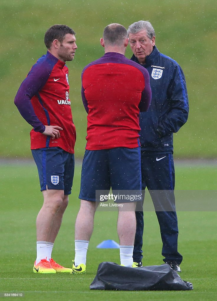 Manager of England, <a gi-track='captionPersonalityLinkClicked' href=/galleries/search?phrase=Roy+Hodgson&family=editorial&specificpeople=881703 ng-click='$event.stopPropagation()'>Roy Hodgson</a> in conversation with <a gi-track='captionPersonalityLinkClicked' href=/galleries/search?phrase=Wayne+Rooney&family=editorial&specificpeople=157598 ng-click='$event.stopPropagation()'>Wayne Rooney</a> and <a gi-track='captionPersonalityLinkClicked' href=/galleries/search?phrase=James+Milner&family=editorial&specificpeople=214576 ng-click='$event.stopPropagation()'>James Milner</a> of England during the England training session at Manchester City Football Academy on May 25, 2016 in Manchester, England.