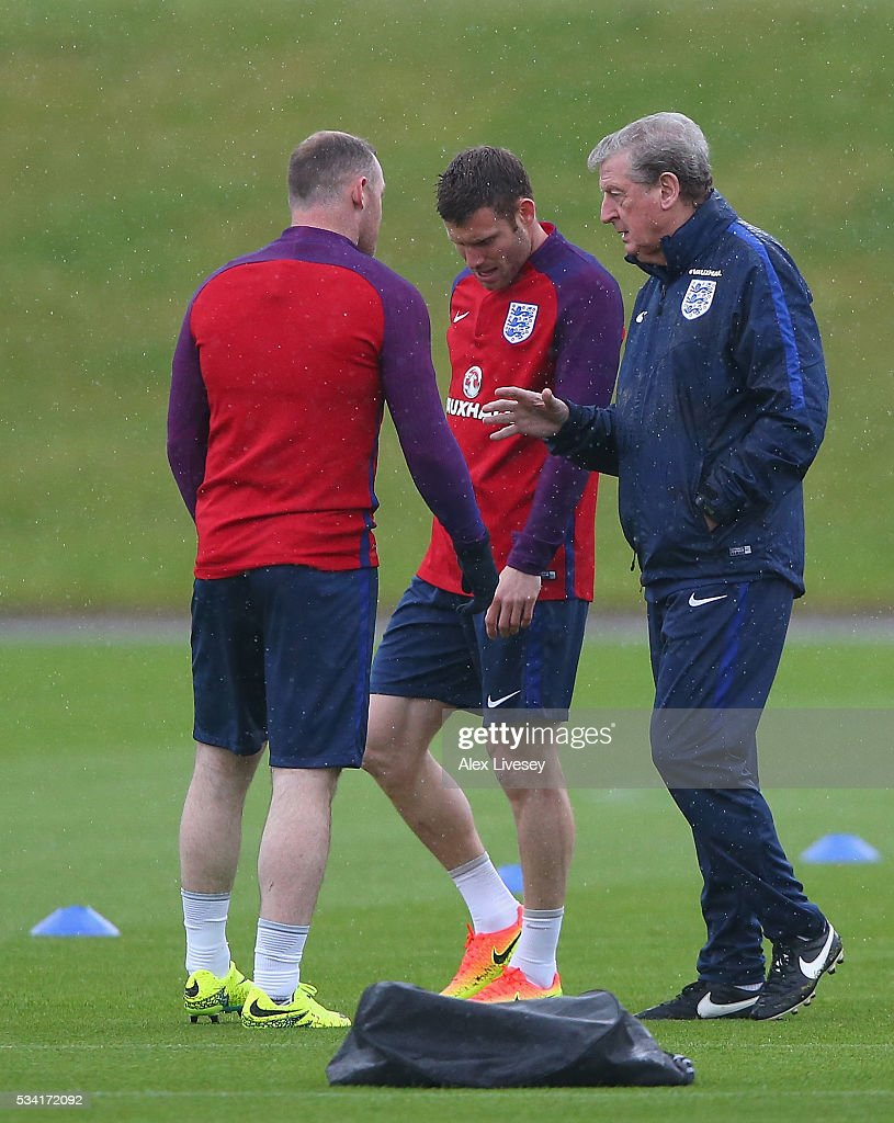 Manager of England, Roy Hodgson in conversation with Wayne Rooney and James Milner of England during the England training session at Manchester City Football Academy on May 25, 2016 in Manchester, England.