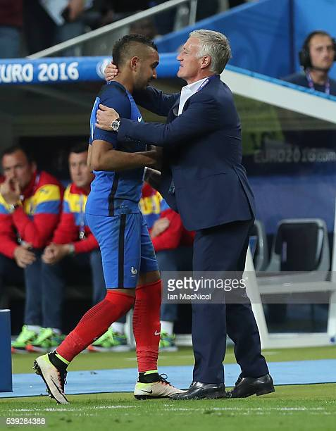 Manager of France Didier Deschamps congratulates Dimitri Payet of France during the UEFA EURO 2016 Group A match between France and Romania at Stade...