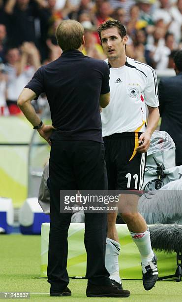 Manager of Germany Juergen Klinsmann shakes hands with Miroslav Klose of Germany after he is substituted during the FIFA World Cup Germany 2006 Group...