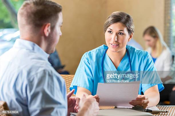 Manager of hospital nursing staff interviewing potential healthcare employee