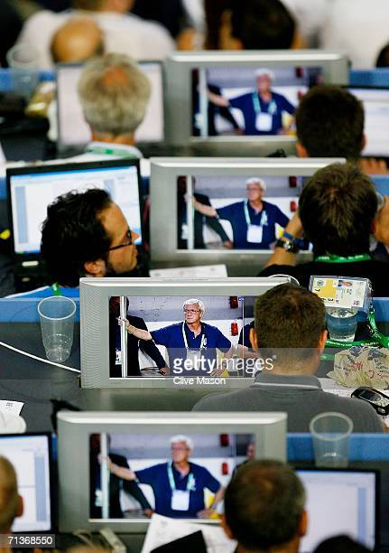 Manager of Italy Marcello Lippi is seen on TV screens in the media tribune during the FIFA World Cup Germany 2006 Semifinal match between Germany and...
