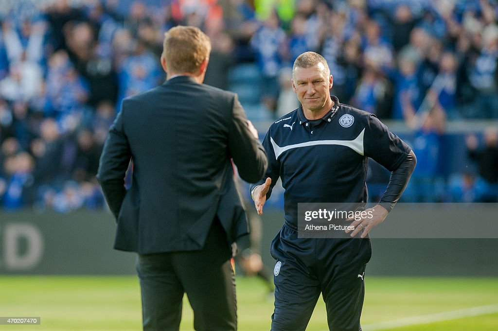 Manager of Leicester City, Nigel Pearson shakes hands with Manager of Swansea City, Garry Monk with a smile on his face during the Premier League match between Leicester City and Swansea City at The King Power Stadium on April 18, 2015 in Leicester, England.