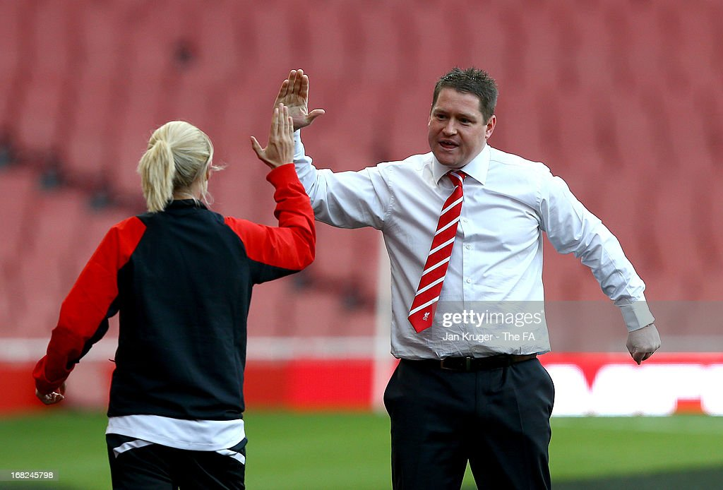 Manager of Liverpool Ladies Matt Beard celebrates a Liverpool goal during the FA WSL Continental Cup match between Arsenal Ladies FC and Liverpool Ladies FC at Emirates Stadium on May 7, 2013 in London, England.