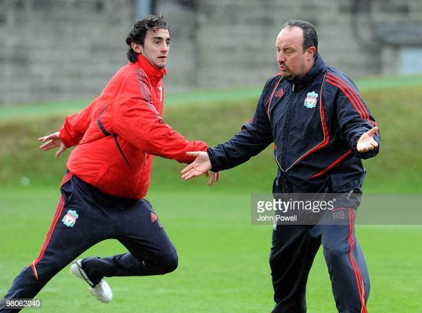 Manager of Liverpool Rafael Benitez with Alberto Aquilani during a training session at Melwood training ground on March 26 2010 in Liverpool England