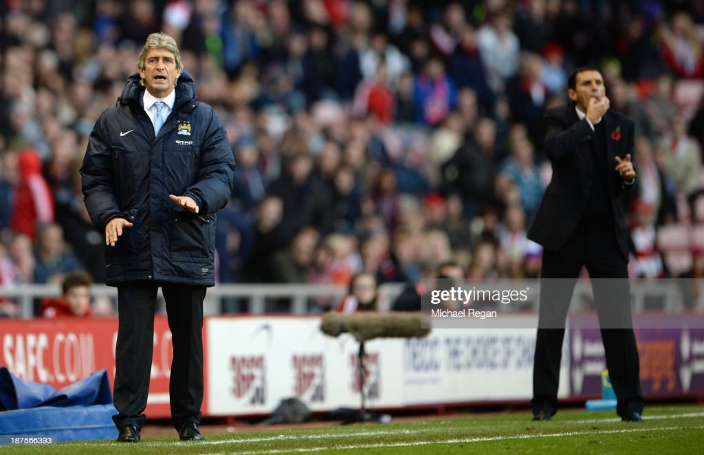 Manager of Manchester City Manuel Pellegrini and Manager of Sunderland Gus Poyet shout instructions during the Barclays Premier League match between Sunderland and Manchester City at the Stadium of Light on November 10, 2013 in Sunderland, England.