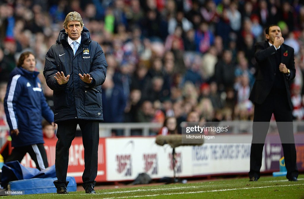Manager of Manchester City Manuel Pellegrini appeals for calm as Manager of Sunderland Gus Poyet makes a point during the Barclays Premier League match between Sunderland and Manchester City at the Stadium of Light on November 10, 2013 in Sunderland, England.