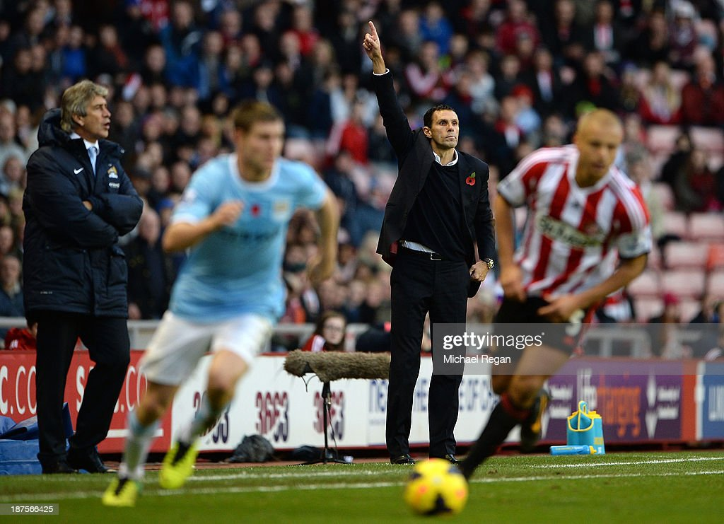 Manager of Manchester City <a gi-track='captionPersonalityLinkClicked' href=/galleries/search?phrase=Manuel+Pellegrini&family=editorial&specificpeople=673553 ng-click='$event.stopPropagation()'>Manuel Pellegrini</a> looks on as Manager of Sunderland Gus Poyet makes a point during the Barclays Premier League match between Sunderland and Manchester City at the Stadium of Light on November 10, 2013 in Sunderland, England.
