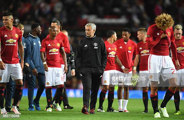 Manager of Manchester United Jose Mourinho and the Manchester United squad look on following the Wayne Rooney Testimonial match between Manchester...
