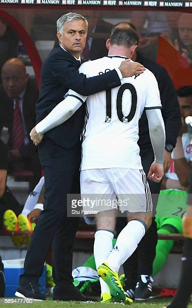 Manager of Manchester United Jose Mourinho hugs Wayne Rooney of Manchester United as he is substituted during the Premier League match between AFC...