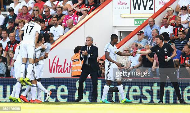 Manager of Manchester United Jose Mourinho talks to his players after the goal scored by Zlatan Ibrahimovic of Manchester United during the Premier...