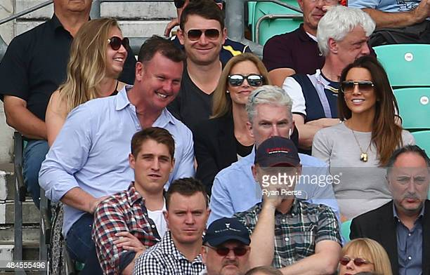 Manager of Michael Clarke of Australia Anthony Bell his wife Kelly Landry and Kyly Clarke wife of Michael Clarke of Australia look on during day one...