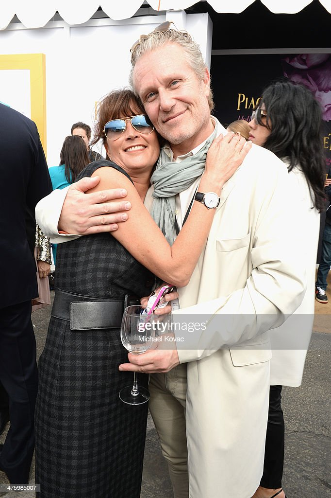 Manager of Piaget Natacha Hertz and Co-founder and CEO of Propaganda GEM Ruben Igielko-Herrlich pose in the Piaget Lounge during the 2014 Film Independent Spirit Awards at Santa Monica Beach on March 1, 2014 in Santa Monica, California.