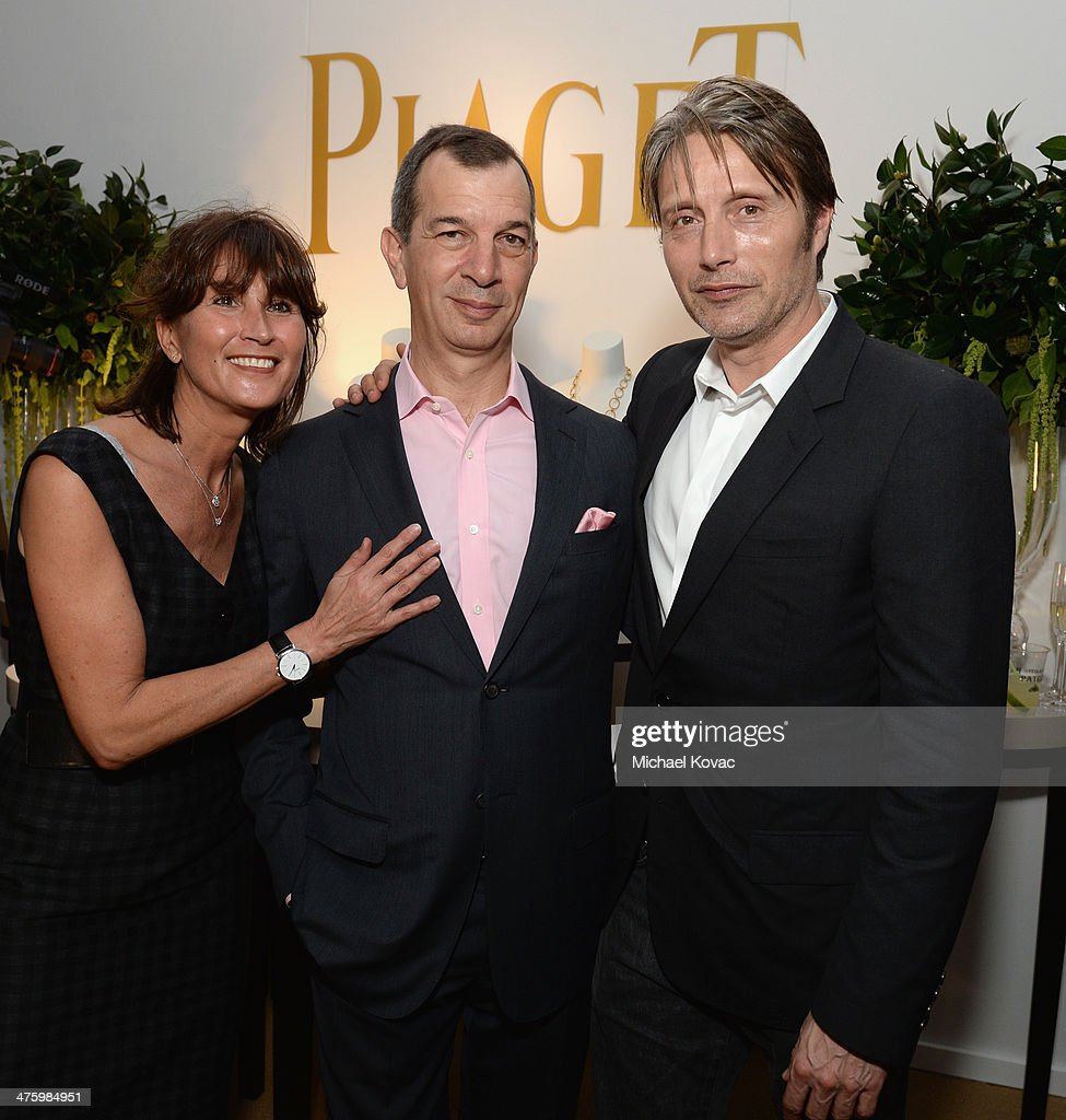 PR Manager of Piaget Natacha Hertz, CEO of Piaget Philippe Leopold-Metzger and actor Mads Mikkelsen pose in the Piaget Lounge during the 2014 Film Independent Spirit Awards at Santa Monica Beach on March 1, 2014 in Santa Monica, California.