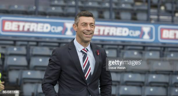 Manager of Rangers Pedro Caixinha walks out to inspect the pitch before the Betfred Cup Semi Final at Hampden Park on October 22 2017 in Glasgow...