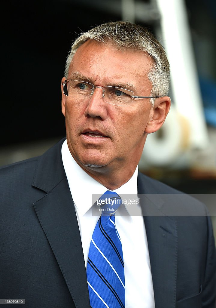 Manager of Reading Nigel Atkins looks on during a pre season friendly match between Reading and Swansea City at The Madejski Stadium on August 02, 2014 in Reading, England.