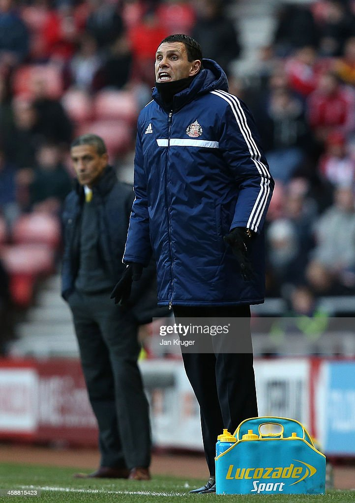 Manager of Sunderland Gus Poyet gives instructions during the Barclays Premier League match between Sunderland and Norwich City at the Stadium of Light on December 21, 2013 in Sunderland, England.