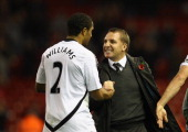 Manager of Swansea City Brendan Rodgers congratulates Ashley Williams of Swansea City after the Barclays Premier League match between Liverpool and...