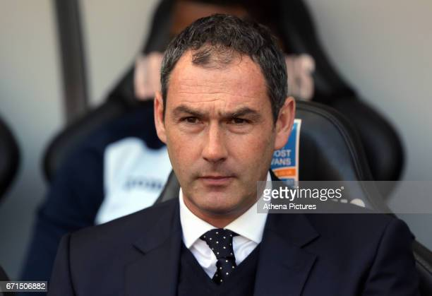 Manager of Swansea City Paul Clement sits in the dug out during the Premier League match between Swansea City and Stoke City at The Liberty Stadium...
