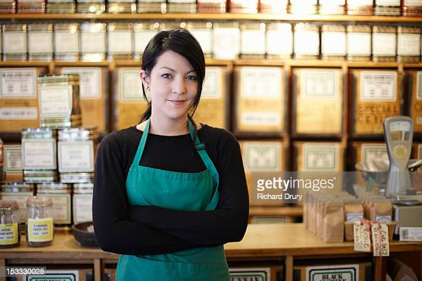 Manager of tea and coffee store in her shop