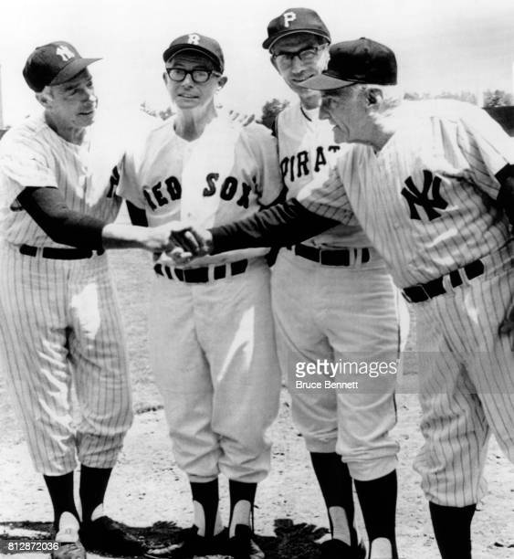 Manager of the American League OldTimers Casey Stengel and New York Yankees shakes the hands of Joe DiMaggio of the Yankees Dom DiMaggio of the...